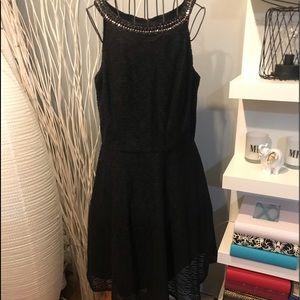 Sandra Darren black dress with jewelry